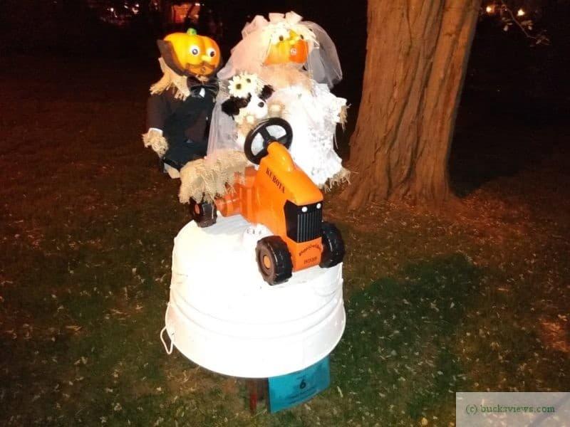 Pumpkin heads on a tractor scarecrows - Peddler's Village 2019